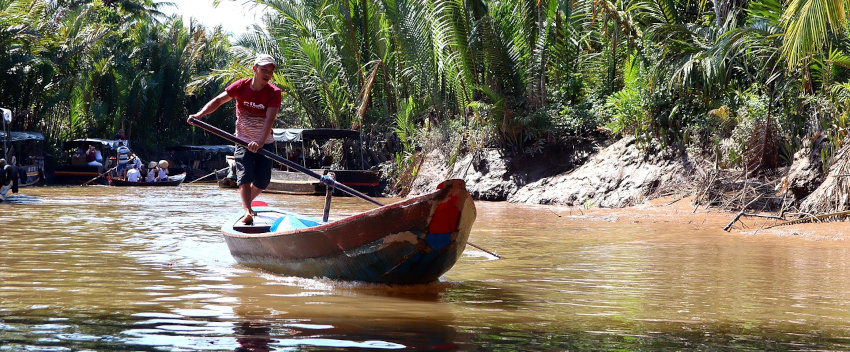 delivery of materials by boat in mekong delta